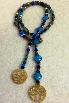 Item No.: NEC-BLAR-482012  Beaded Lariat Necklaces  Circle Carved Pendants by hebaalayyan, $43.00
