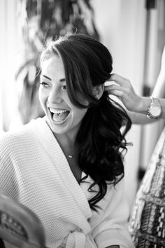 Gorgeous bride having her side ponytail styled by her hairdresser!