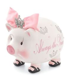 Royal riches fit in this ceramic bank. She's one pretty piggy in satin and rhinestones. 'Always the princess' is written on it's side. From Chasing Fireflies.