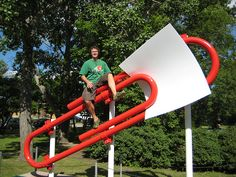 The world's largest paperclip measures 15 feet, 2 inches in height and 45 feet long, and was constructed from solid steel. It was created in Saskatchewan, Canada in July of Statues, Attraction World, Roadside Attractions, Unusual Things, Outdoor Art, World's Biggest, World Records, Saskatchewan Canada, Canada Travel