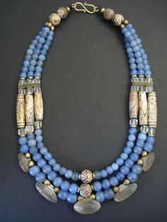 Antique Glass, Clay & Rock Crystal Bead Necklace.    A triple strand necklace full of wonderful rare and old beads. Many subtle hues of blue in the glass beads from Burma go beautifully with 12 antique early 20th century clay beads from Tibet/Nepal purchased by Rick Bennett on Thai/Burma border in 1982.