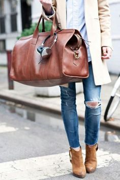 #Travel ready with leather satchel, headphones, and suede booties. #streetstyle