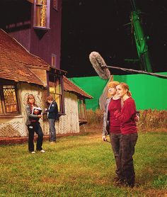 Rupert Grint and Emma Watson on the set of Harry Potter and the Deathly Hallows: Part 1 (2010), directed by David Yates.