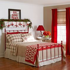 Bedroom with holiday decorations and a wall shelf beneath a stenciled mirror - DIY Christmas and holiday decorations - Styled by Lowe's Creative Ideas - Royal Design Studio stencils