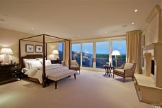 Big open bedroom with huge sliding glass door out to the back. Fireplace with crown molding along the ceiling.