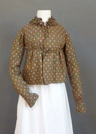 Printed Jacket with button and frill detail including two thread work loops above the buttons where an apron may have threaded through.   No date - most likely early 19th century Meg Andrews