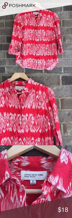 Jones New York Red Striped Linen Blouse Made from linen, this rolled sleeve top by Jones New York is great for wearing by itself or for layering. The bold pattern really makes the piece. In great condition, small spot on front. Approximate measurements lying flat: 20' bust, 24.5' length 10335 Jones New York Tops Button Down Shirts