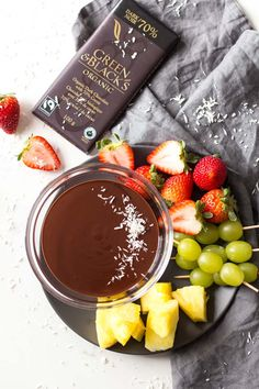 This decadent and healthy Dark Chocolate Fondue recipe makes a perfect fun treat for 2 on Valentine's Day or a date night in. I am including plenty of chocolate fondue dipping ideas as well as instructions for how to adjust this recipe to make it feed a party crowd.  Sponsored | #Darkchocolate | #chocolatefondue | Simple | Dairy Free | Families | Valentines | Desserts | Fresh Fruit | Holidays | Coconut Milk | Dips