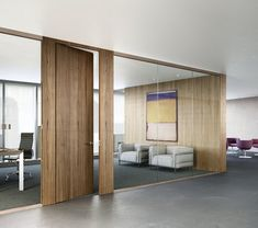 Glass office with wood walls and door