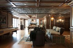 In addition to a game room and pub on the lower level, pictured, the property also has a movie theatre, additional bar areas and a wine cellar. Mrs. Hornung declined to disclose the cost of improvements to the home, but said it was in excess of what the house is being sold for. The pub and game room leads to a balcony through French doors and features a mahogany handcarved bar. The room has a paneled tin ceiling with different motifs over different seating areas.
