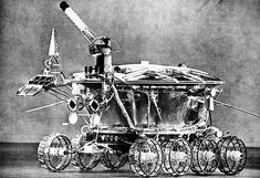 Lunokhod 1 rover. The helical rod point to the upper left is a high gain antenna; the cone shaped object is a low gain antenna. The retro-reflector, with the cover opened, is just below the low gain antenna.