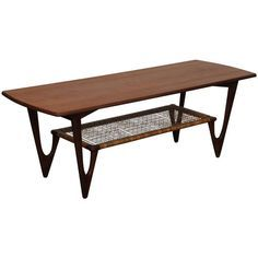 Mid Century Teak Coffee Table By Kurt Ostervig | From a unique collection of antique and modern loveseats at http://www.1stdibs.com/furniture/seating/loveseats/