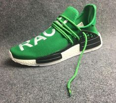 "5e57aaec7c54e Pharrell s suave touch lands on the adidas NMD Primeknit with a new ""cage""  that features thick rope laces and HUMAN RACE embedded into the knit uppers."
