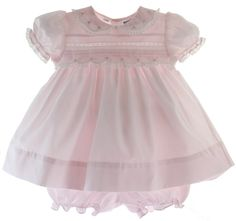 Buy Infant girls pink dress with round Peter Pan collar has lace trim on the collar, sleeves and across the chest. Infant girls pink short sleeve dress has white embroidered roses, white lace insertion, ties in the back with a sash and comes with matching pink baby bloomers.65% Polyester 35% Cotton