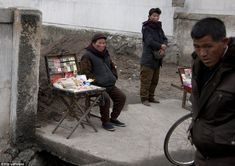 Eking a living: Although the regime has cracked down on the black market, the 'grey market...