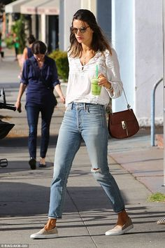 Added extras:The Victoria's Secret Angel finished off the look with a pair of slip-on canvas shoes, tortoiseshell sunglasses and a Chloe bag