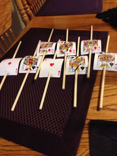 Hole punched regular cards and put them on sticks to decorate the cookie and marshmallow sticks that they will become. Las Vegas casino night theme party ideas and treats