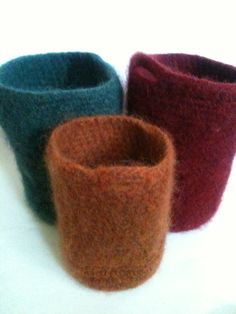 After 2 cycles in the washing machine, these crocheted, wool tweed storage vessels are now dry & looking good