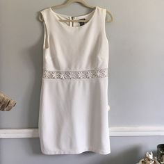 White floral dress! I wore this twice--one graduation and one for my internship. It has wear around shoulders but with a good bleaching or cleaning it could be removed. Middle part is slightly see through Dresses