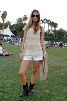 A see-through shirt and Frye boots in front of the main stage.
