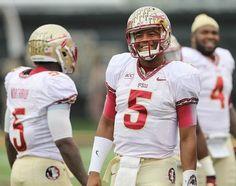 FSU quarterback Jameis Winston flashes his trademark smile after a Seminole touchdown.