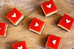 white chocolate cheesecake squares with strawberry glaze -