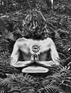 This graphic design image began with a photo shoot on the Blue Ridge Mountains in Loudoun County. The yoga instructor posed grasping a sunflower behind her back. The photo was then edited with various techniques applied.    An eye was added to the center of the sunflower, which topped off the high contrast, black and white effect of the image. The ferns in the background play upon the curls in her hair. The overall image in a striking example of what the mind, and body, is capable of.