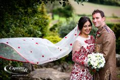 Brides beautiful white and red veil at Old Down Manor wedding