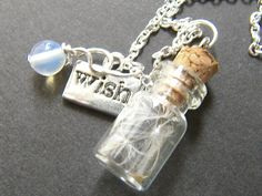 Glass Vial with Dandelion Seeds Charm Necklace  by WishesontheWind, £13.00