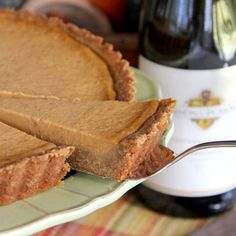 It tastes just like a pumpkin pie but instead of a traditional pie crust, this dessert has a gingersnap cookie crust.
