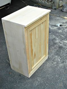 An easy way to hide an eyesore! See how to make this DIY Wooden Wastebasket Cabinet Diy Wooden Projects, Wood Shop Projects, Woodworking Projects Diy, Wooden Diy, Pallet Projects, Wood Crafts, Wood Trash Can Holder, Wooden Trash Can, Kitchen Garbage Can Storage