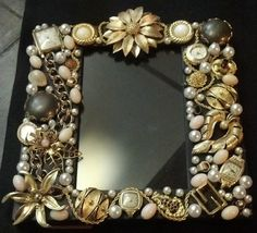 Frame covered in vintage jewelry and antique watches