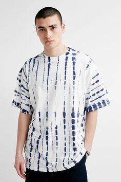 Shop UO White Batik Short-Sleeve T-Shirt at Urban Outfitters today. Tie Dye Fashion, Batik Fashion, Diy Tie Dye Shirts, Tie Dye Crafts, Shibori Tie Dye, Batik Pattern, African Men Fashion, Tie Dye Patterns, Menswear
