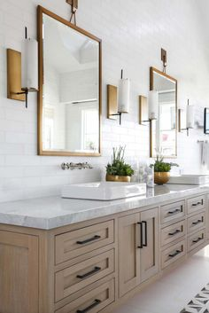 BECKI OWENS- Bathroom Trend: Warm Wood Vanities We're sharing beautiful bathrooms today that all pair warm wood vanities in golden tones with crisp white walls and marble. You're going to love the look. White Vanity Bathroom, Wood Vanity, Warm Bathroom, Bathroom Colors, Bathroom Sconces, Top Mount Bathroom Sink, Wood Bathroom Cabinets, Master Bathroom Vanity, Silver Bathroom