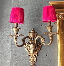 Pink silk candle shades on an antique wall lights at Trusha Lakhani Antiques