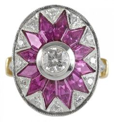 "Ruby and Diamond Art Deco Ring, early 20th century, center bezel-set .44 ct. round brilliant diamond, 12 modified navette-shaped step-cut genuine rubies, estimated combined weight 1.50 ct,  16 round brilliant diamonds, estimated combined weight .20 ct., mount marked ""18k"" yellow and white gold."