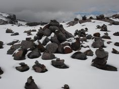 Man of stone. Signs not to lose the way. Nevados de Colombia.