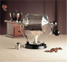 Hario Glass Non-Electric Home Roaster: - Roasts of green coffee - Non-electric - Uses easy-to-find denatured alcohol - Hand-cranked Elegant and Functional Glass Roasting Chamber Chemex Coffee Maker, Coffee Cans, Coffee Shop, Roasters Coffee, Coffee Barista, Grinding Coffee Beans, Coffee Roasting, Electric Roaster, Specialty Appliances