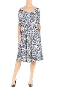 Pretty pleats detail the scooped neck of our floral print dress, box-pleated and nipped in at the banded waist for a figure-flattering silhouette.