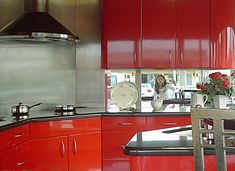 Red painting the kitchen cabinets