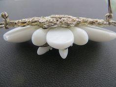 Miriam Haskell Glass Brooch, White Milk Glass Pin, Designer Signed Jewelry  Vintage Miriam Haskell milk glass brooch with tiny glass and navette stones on a filigree settin... #vintagevoguetreasure #1950s