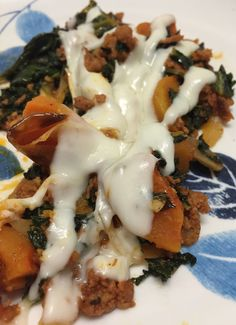 Kale, spinach, butternut squash, longaniza sausage, onions, garlic, and a bit of mozzarella cheese.  I have to remember this recipe.  It was so good, I almost forgot to snap a photo of it!  I'll post recipe once I measure out the ingredients.