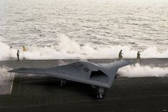 100215-N-0000X-001 WASHINGTON (Feb. 15, 2010) An artist's conception of the X-47B long-range unmanned aerial vehicle on the flight deck of an aircraft carrier. The Unmanned Combat Air System Carrier Demonstration program will demonstrate the capability of an autonomous, low-observable unmanned aircraft to perform carrier launches and recoveries. (Photo illustration courtesy Northrop Grumman/Released)