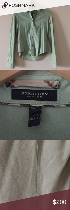 Burberry goat suede blouse Super soft Burberry blouse. It is 100% goat suede. It was made in Italy. There are 2 small white stains on the back as shown in pictures. Burberry Tops Blouses