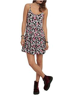 Black dress with a skulls and roses print and crisscross strap detailing on the back.