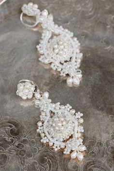 Luminous freshwater pearls embellish hand-woven lace motifs on these vintage-inspired bridal drop earrings. A delicate edging of wired pearls and glass beads give the Primrose Earrings an airy and romantic feeling--a perfect finishing touch to a lace wedding gown.