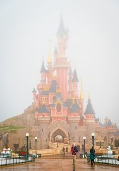 Sleeping Beauty Castle in the fog at Disneyland Paris. This and 50 other beautiful photos in this Disneyland Paris trip report!