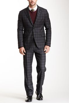 """Dim Grey Windowpane Two Button Notch Lapel Suit in dim gray by Armani Collezioni Tailored Clothing $2195 - $979 @HauteLook. Jacket: - Grey windowpane wool fabric - 2 button closure - Notch lapel - Flap welt pockets - 4 buttons on each sleeve - 3 interior pockets  - Approx. 28"""" length Pants: - Flat front - Front slant pockets  - 11"""" rise, 35.5"""" inseam Shell: 100% wool. Lining 1: 52% cupro, 48% acetate. Lining 2: 66% acetate, 34% polyester. Pant: 100% wool. Made in Italy"""