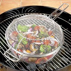 Mesh Chef Pan for grilling out. yum. Read more about outdoor cooking tools in our April 28 At Home section.