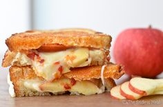 Grilled Cheese and Apple Sandwich with Sriracha Butter.  Tried a variation with colby jack cheese and it was delicious!  Next time with cheddar, for sure.  (And though I'm sure it tastes near perfect with the Sriracha Butter, it's plenty tasty without it, too ;P)